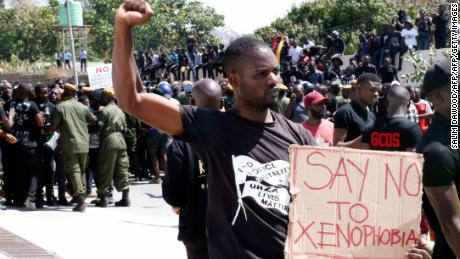 south african police arrest 100 against xenophobia